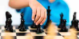 A women playing chess
